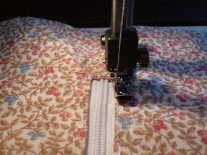 Narrow zipper foot being used to sew on a zipper (Sewn By Tanya Sewing Tip - narrow zipper foot)