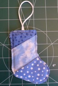 Top of stocking oblique to patchwork stitching. (Scrappy Stocking Ornament project review by Sewn By Tanya)