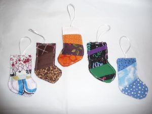 5 assorted Scrappy Stocking Ornaments (Scrappy Stocking Ornament project review by Sewn By Tanya)