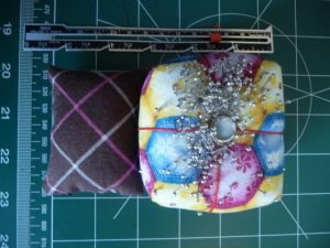 Filled emery pouch and a batting filled pin cushion  (Sewn By Tanya sewing tip)