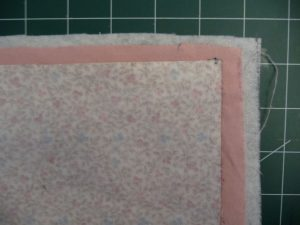 2 fabrics and fusible fleece cut and layered for Easy Phone Charger Holder (project review by Sewn by Tanya)