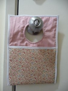 Easy Phone Charger Holder hanging over doorknob (project review by Sewn By Tanya)