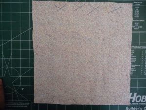 Cut fabric rectangle or square to make continuous bias strip