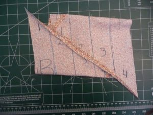 Sew along the grain line and press open the seam when making continous bias strip