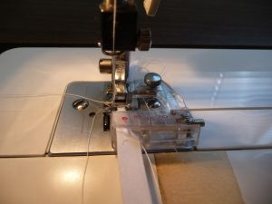 Attach bias tape foot to sewing machine then adjust arm/needle position (Sewn By Tanya Sewing Tip)