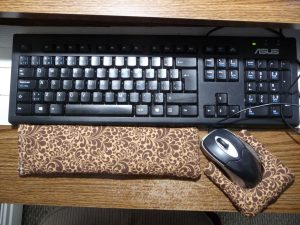 Keyboard rest and mouse rest beside computer keyboard and mouse