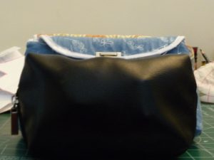 Front view of old makeup bags