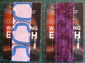 Completed reversible bookmark on a book
