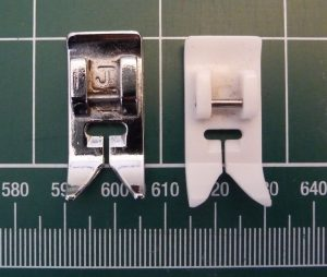 Two sewing maching presser feet side by side