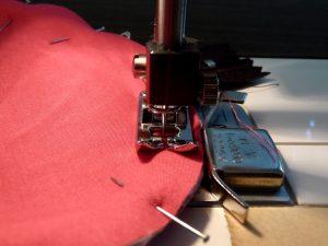 Closeup of sewing machine presser foot & magnetic seam gauge