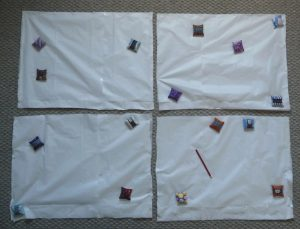 4 rectangular stacks of silk & tissue paper