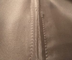 White invisible zipper sewn into white silk
