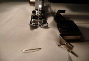 Close up of sewing white silk