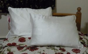 Finished DIY SIlk Pillowcases on a bed