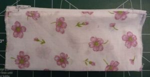 Completed coin pocket; fabric is white with pink flowers