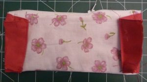 Pink accordion panels sewn onto white and pink coin pouch