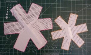 Asterisk shaped paper templates for large & small pot protectors on a green cutting mat