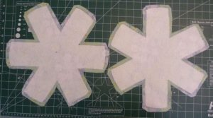 2 fabric asterisks with fusible fleece attached