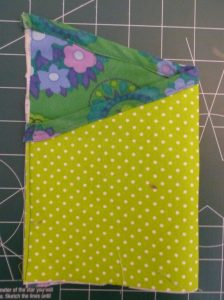 Completed green pocket peice on a green cutting mat