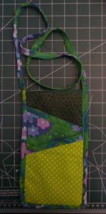 completed Travel Neck Wallet on a green cutting mat