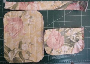 Quilted gusset, back panel and front panel on a green cutting mat