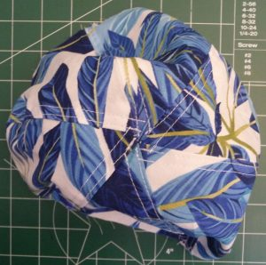 Top view of sun hat top made with a blue tropical print