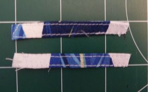 Closeup of neck strap loop peices