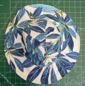 Top view of sun hat with tropical print
