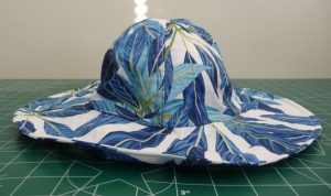Side view of sun hat with tropicalo print