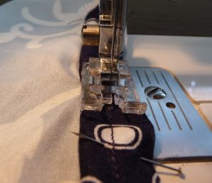 Closeup showing piping being sewn to a single layer of fabric