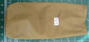 "Khaki silnylon rectangle with a white ""SUL"" label"