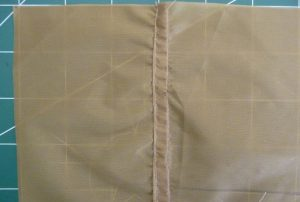 2 pieces of khaki silnylon joined with a flat felled seam