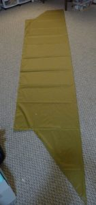 Khaki silnylon piece on a grey carpet