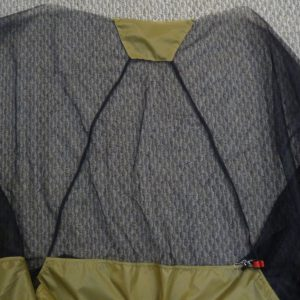 Overview of shelter's front panel showing black mosquito mesh triangle with khaki silnylon at the peak and along the bottom