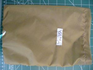 """Closeup of khaki silnylon rectangeular stuff sack with a white """"YAMA"""" label"""