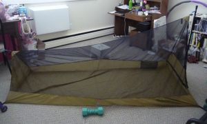 Side view of triangular prism-shaped shelter made from khahi silnylon & black mosquito mesh