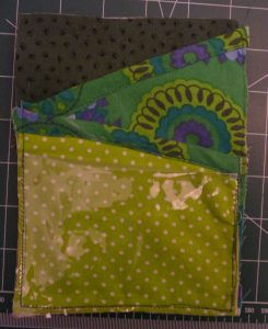 Pocket piece made with cleary vinyl & 3 different green fabrics