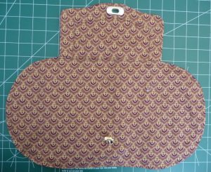 Brown fabric rectangal & fabric oval on a green background