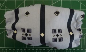 Rectangular mask sewn from blue patterned fabric