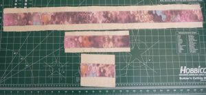3 horizontal strips of canvas with multicolored pink applique