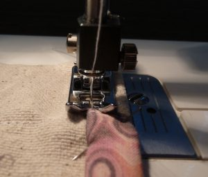 Close-up of sewing folded edge