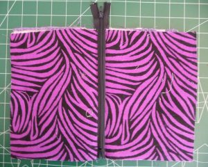 Purple zipper assembly on a green background