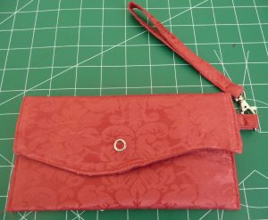 Red Simple Clutch on a green background