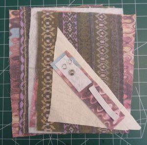 Pile of multicoloured fabrics and notions to make a Mini Portfolio