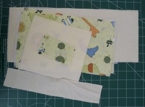 Cut materials for Oue The Door Organizer on a green background