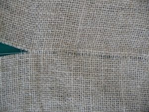 Closeup of channel in brown burlap