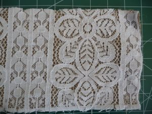 White lace and brown burlap pinned right sides together