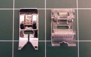 Close up of metallic universal presser foot (left) and clear plastic roller foot with silver wheels (right)
