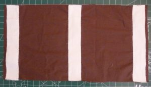 White grip fabric on top of brown desk mat backing