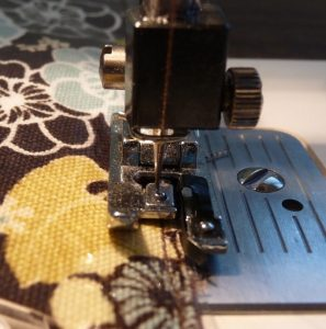 Close up of basting clear vinyl along the desk mat